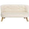 Kremowa sofa do pokoju dziecka